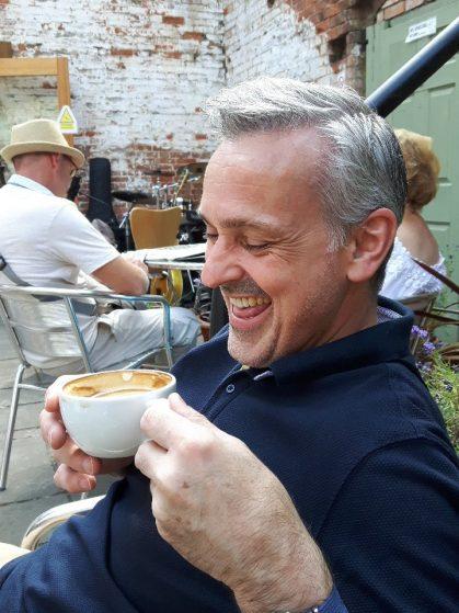 Si Potts - enjoying a latte at a gig.